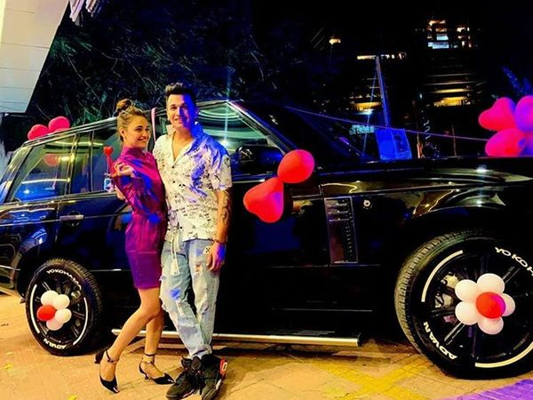 Prince Narula and Yuvika Chaudhary pose with Range Rover